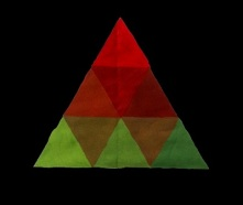 Triad against black background